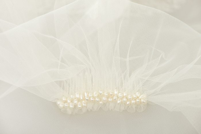 Ivory bridal wedding veil with a pearl comb under the veil