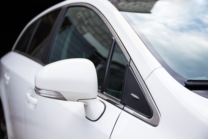 close up of white car rear view mirror