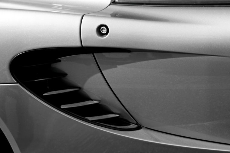 Close up of the air scoop on a metal-fleck silver automobile