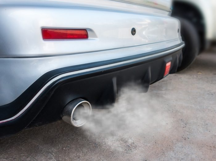 Car exhaust pipe comes out strongly of smoke, air pollution concept.