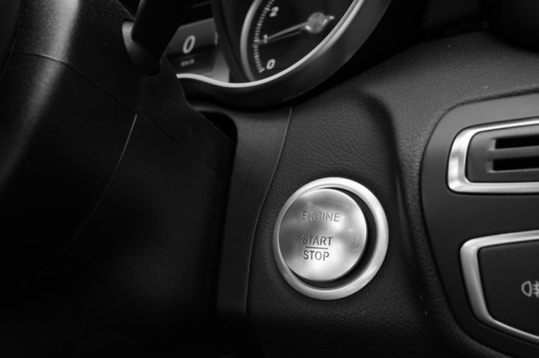 Start Stop Engine button in luxury car in black and white photography