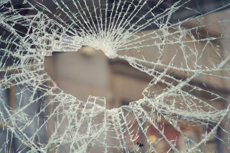 Hole in broken shattered security glass, insurance, security, vandalism or crime concept, shape of Czech Republic