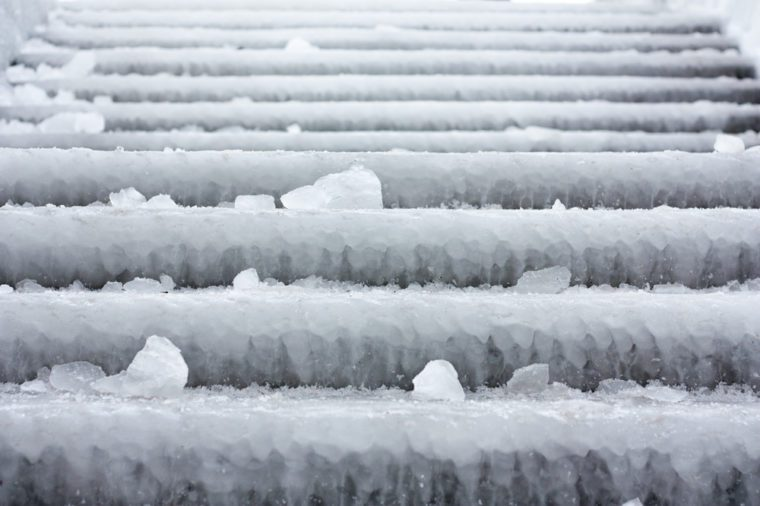 Stairs on the boardwalk covered with ice from the cold Russian winter