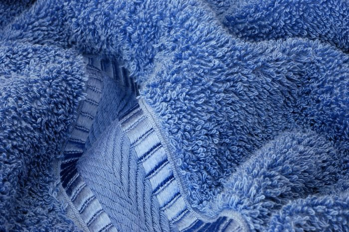 Macro image showing texture and details of a plush, terry cloth bath towel.