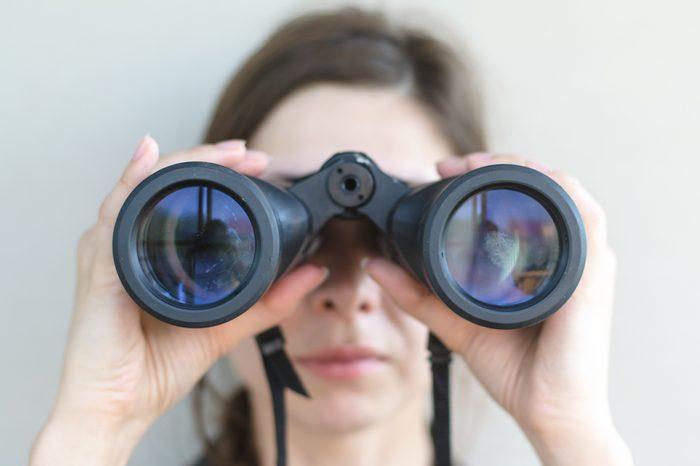 Girl looking through the binoculars.