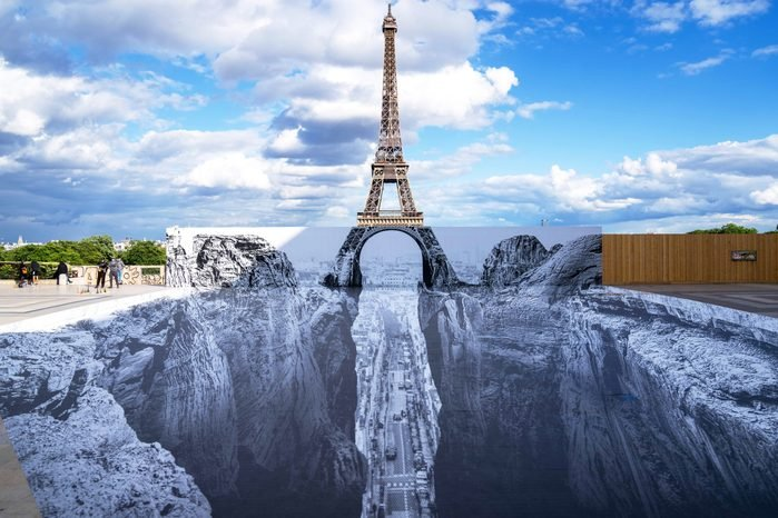 PARIS, FRANCE - MAY 19: A giant artwork by French street artist and photographer Jean Rene Aka JR Is displayed at Esplanade Des Droits De L'homme, at Trocadero on May 19, 2021 in Paris, France.
