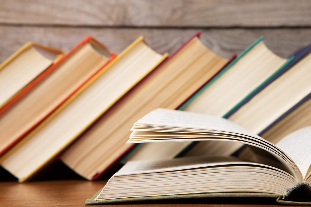 Open book on the wooden background