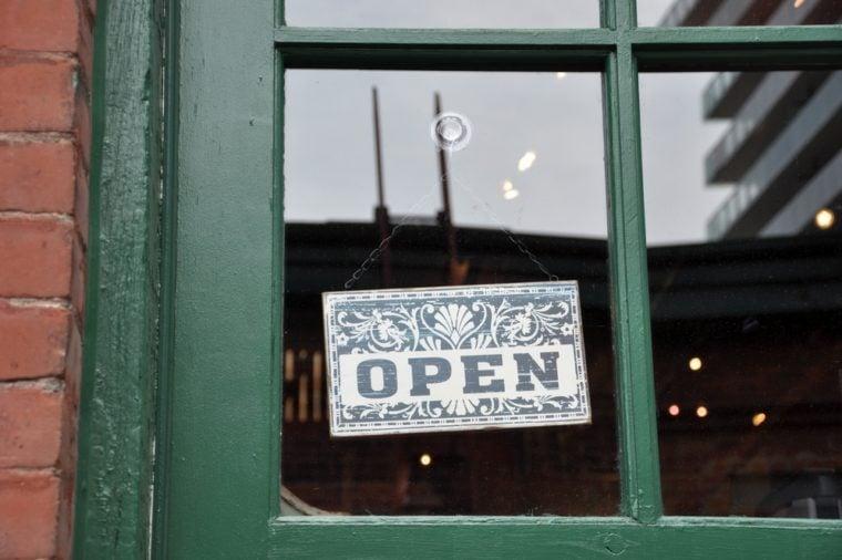 Open signage hang on the glass door