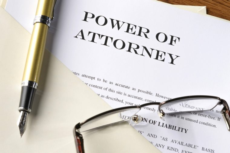 fountain pen, glasses and power of attorney file