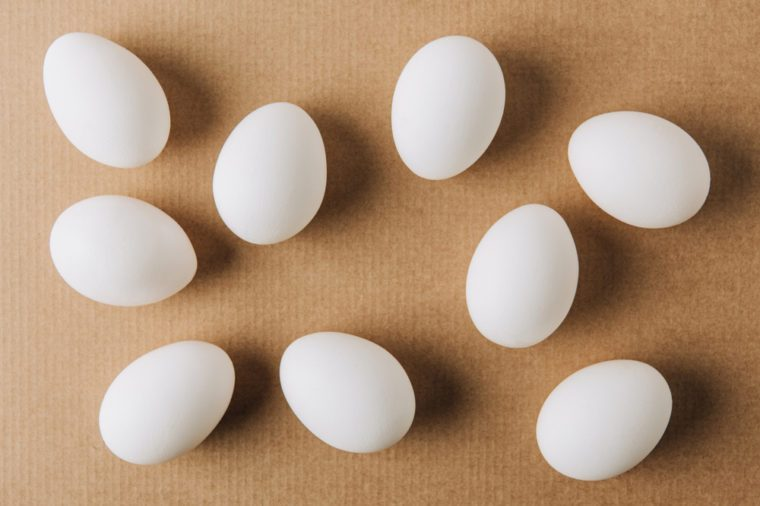 white eggs scattered on brown carton