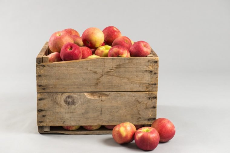Wooden crate full of apples with space for text