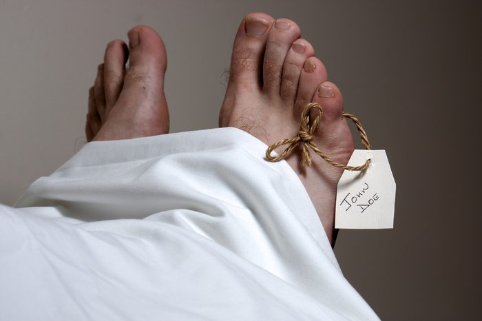 A John Doe name tag on the foot of a body