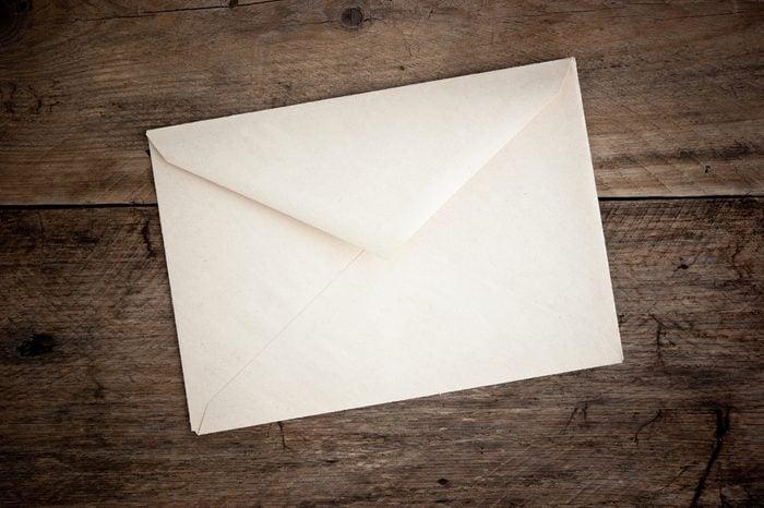 old postal envelope on wooden background