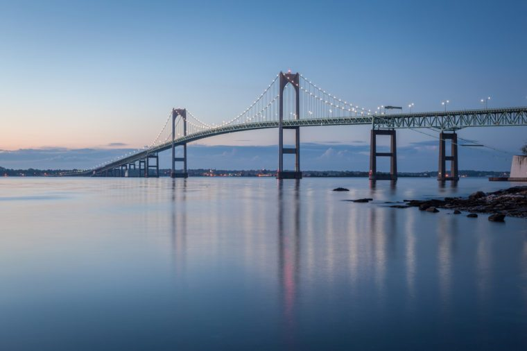 Newport Bridge Twilight Sunrise / This is a long exposure morning sunrise image of the Newport Bridge from Taylor Point near Jamestown, Rhode Island, USA. This is a horizontal image.