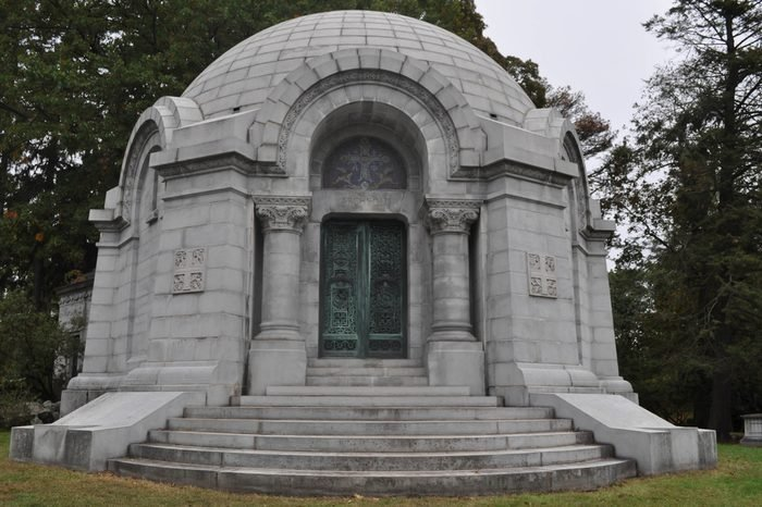 Round Mausoleum with Decorative Iron Doors in a Cemetery
