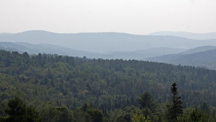 A vista displaying the Green Mountains of Vermont on the horizon.