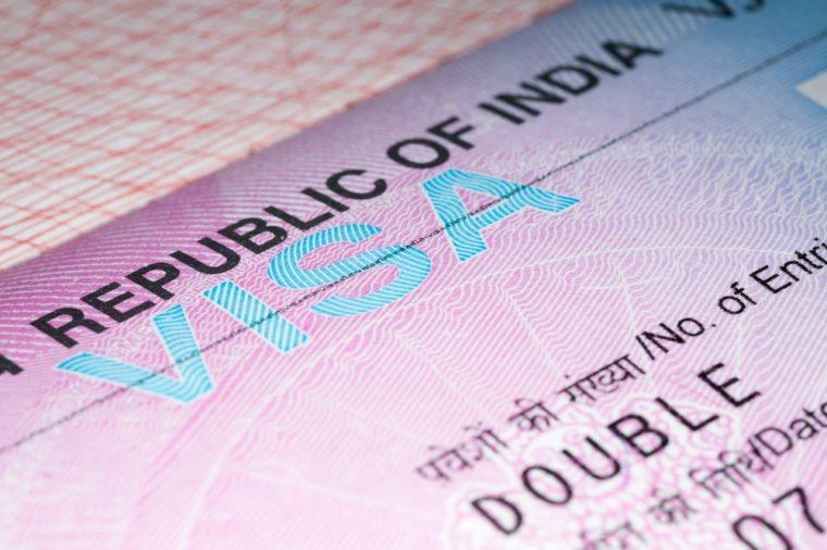 Visa to India. Close-up of visa to Republic of India in passport. Selective focus