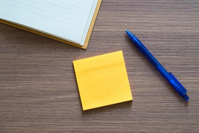 blank notepad with pen and notebook on wooden background