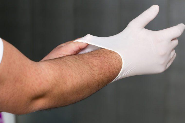 dentist puts gloves