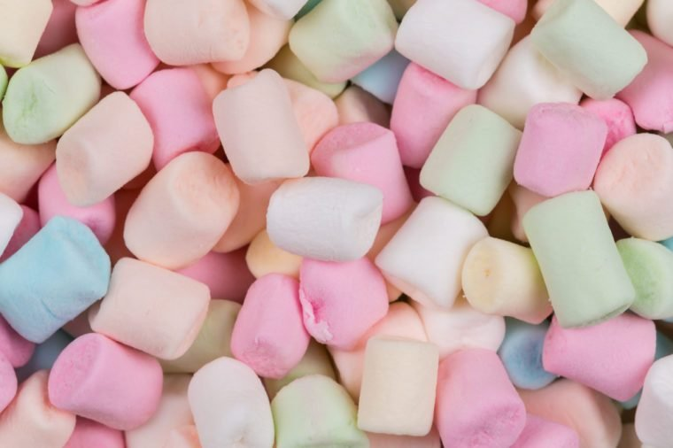 Colorful marshmallows as background, macro. Fluffy marshmallows texture close up.