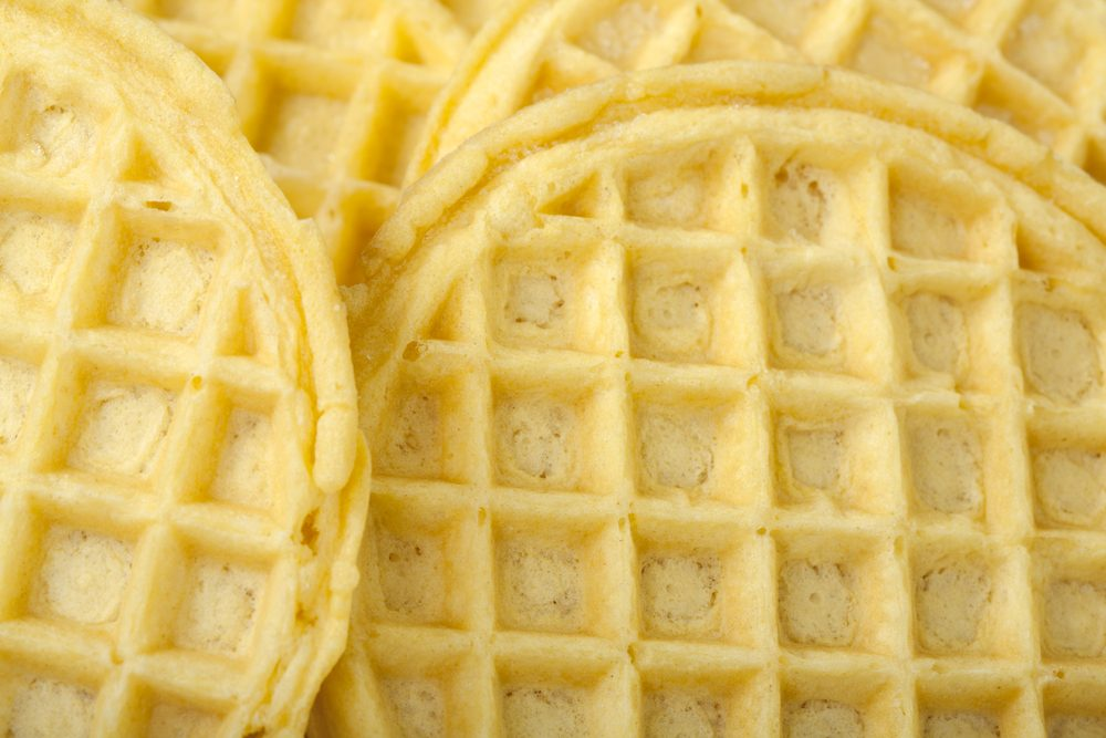 Frozen buttermilk waffles background; close up view
