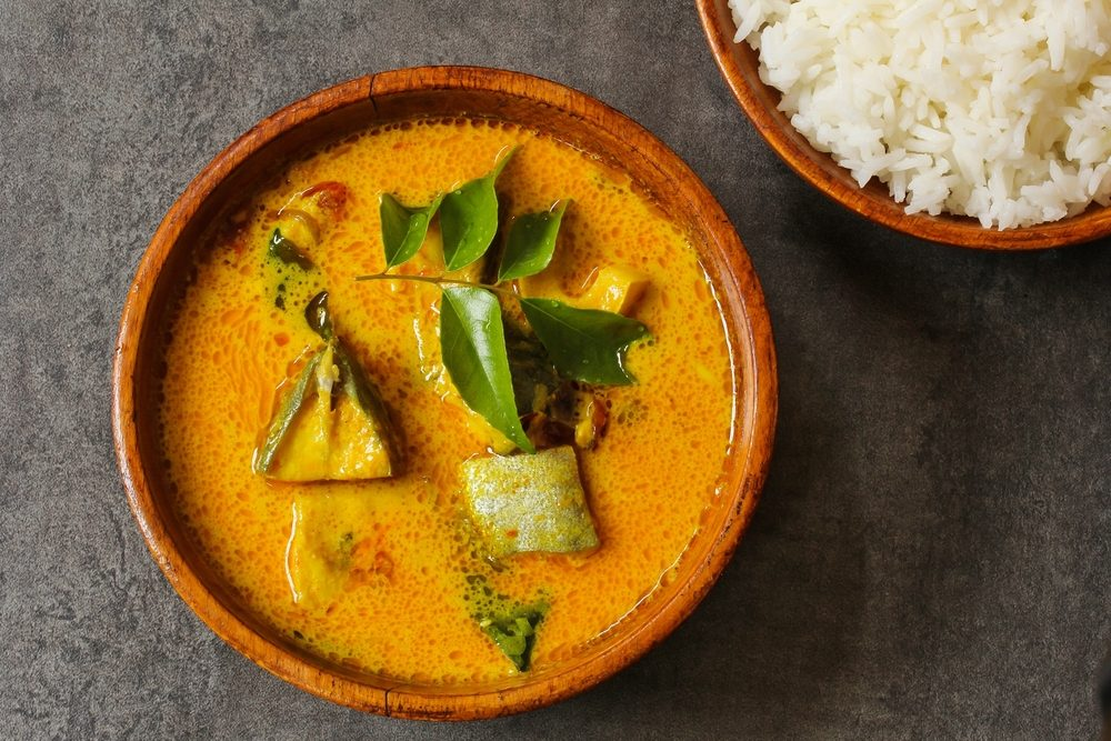 Kerala fish curry cooked in coconut milk, overhead view