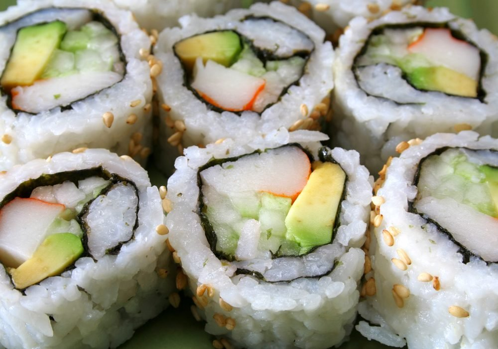 a row of sushi/ California rolls