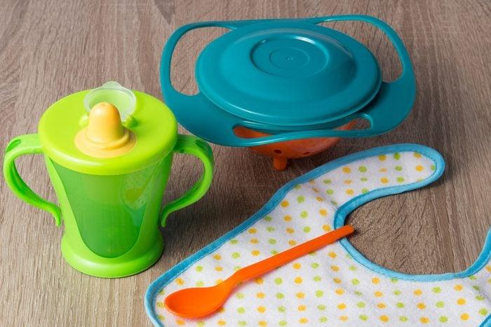 Baby plastic gyro bowl, plastic cup, spoon, bib.