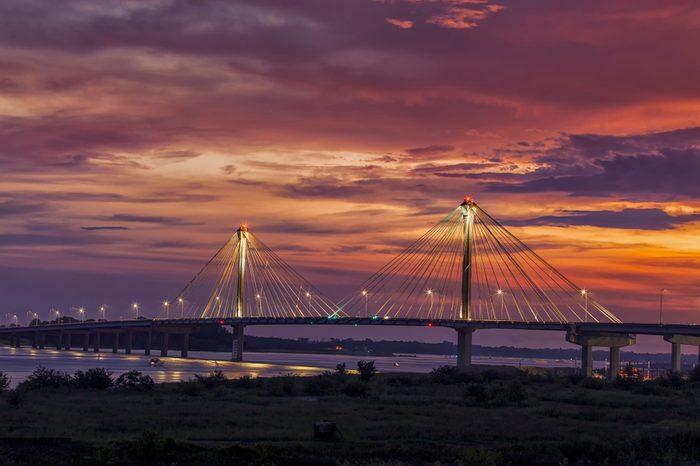 Colorful Sunset over Clark Bridge on Mississippi river Alton, IL