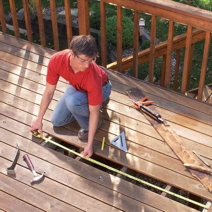 man repairing his deck