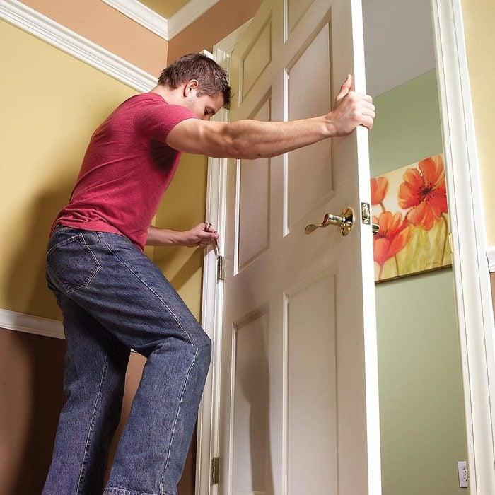 A man fixing a door