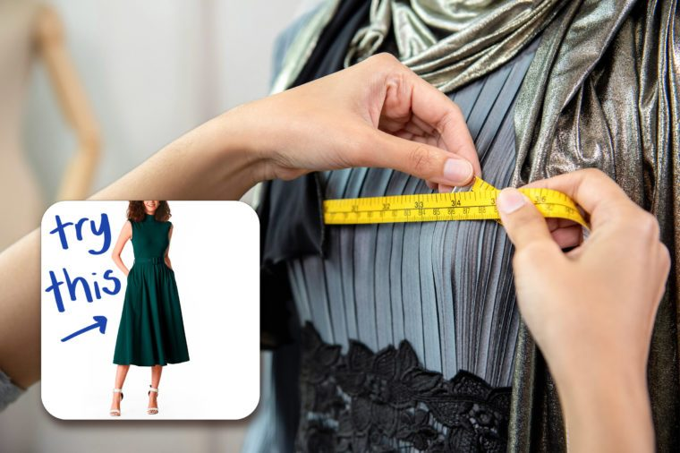 woman's hands using tailor's measuring tape on a mannequin