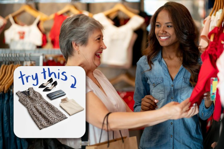 saleswoman assisting another woman in a clothing store