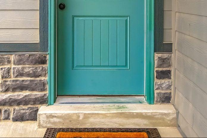 bottom of a blue front door