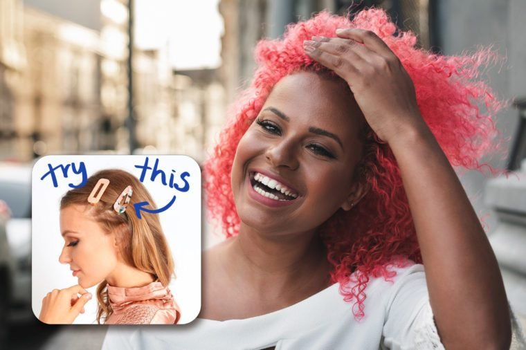 smiling woman with pink hair