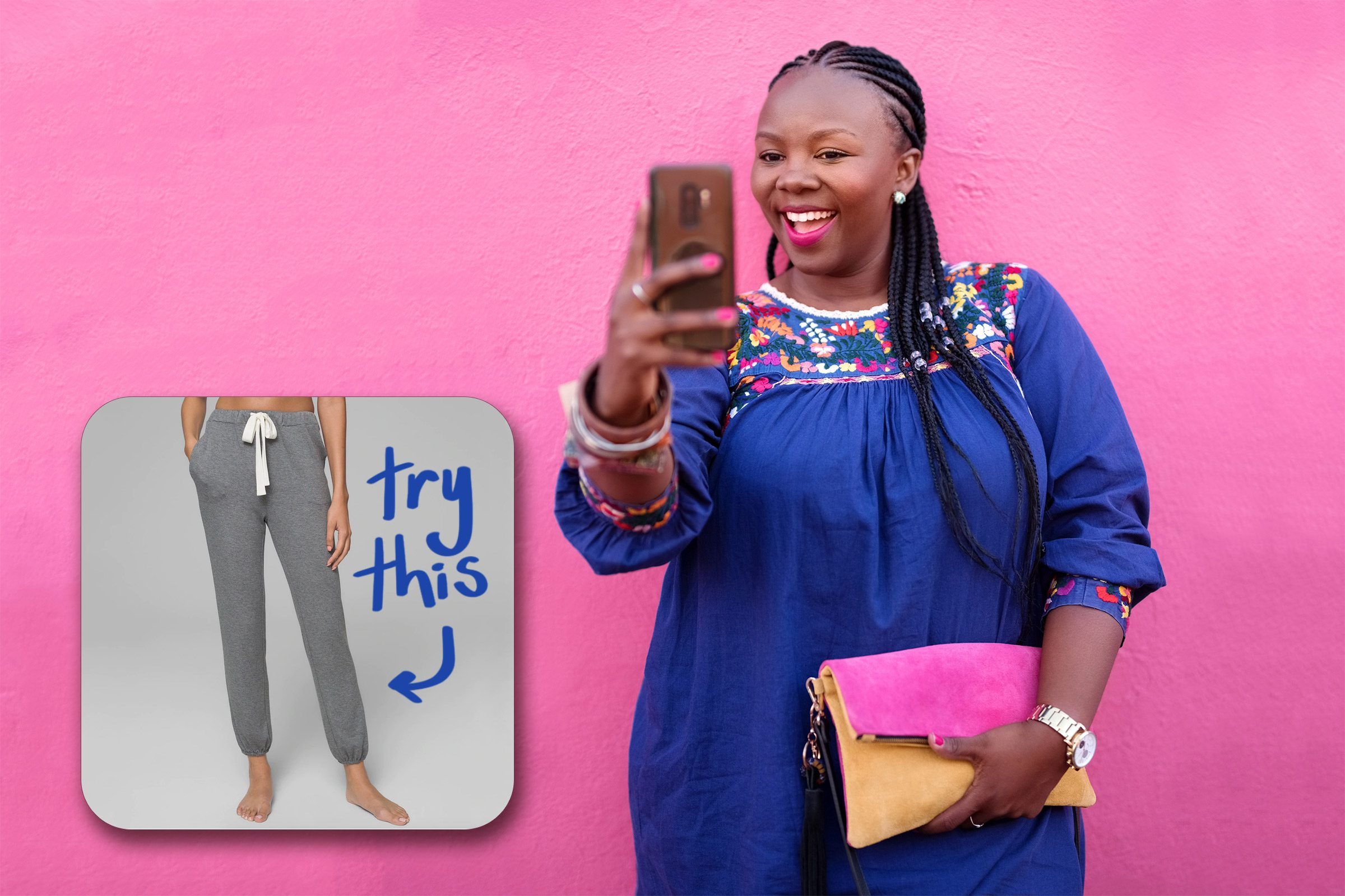woman taking a selfie against a pink wall. try this sweatpants.