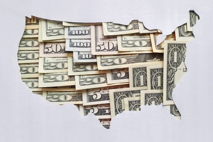 cut out map of the united states with u.s. money bills in negative space