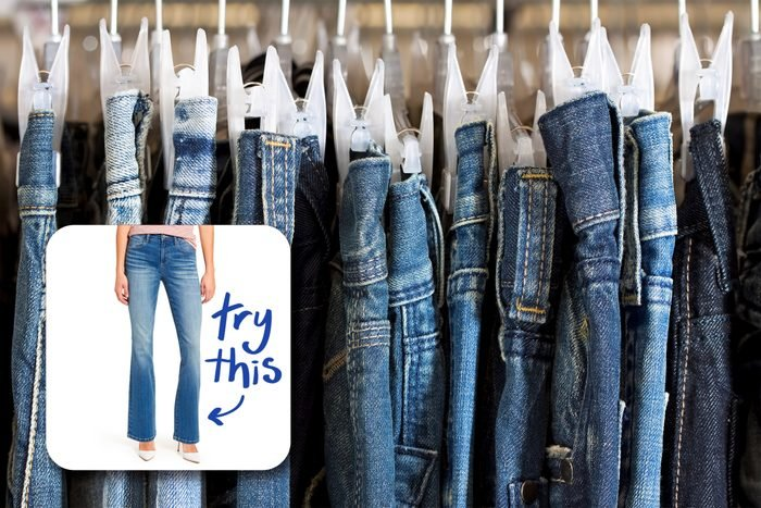 jeans on hangers in a store