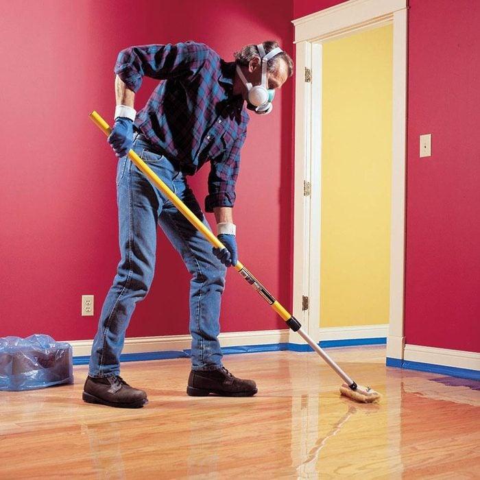 man finishing hardwood floors