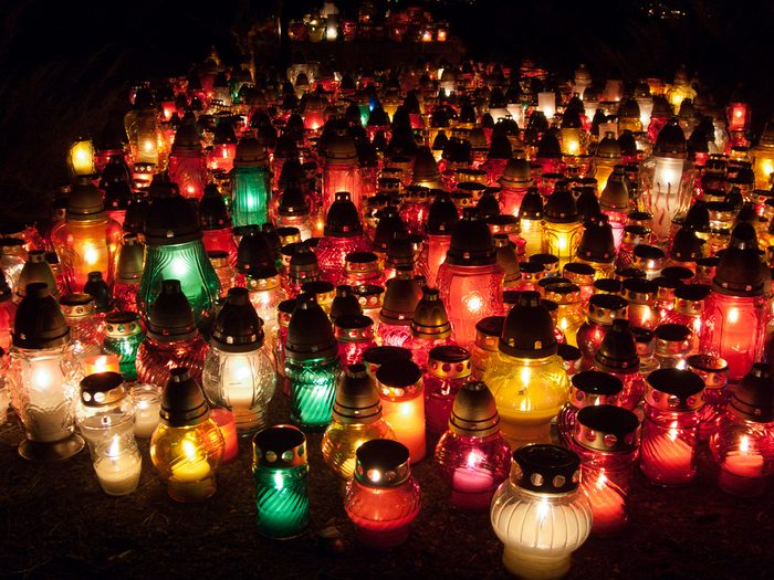 All souls day. Multicolored candles lit to celebrate All Souls Day. They symbolize our memory of loved ones who have passed away. They express our respect to them.