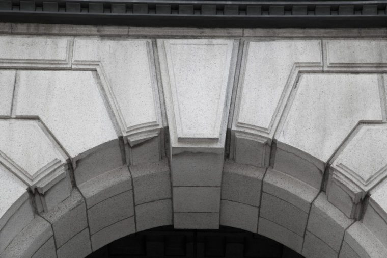 A closeup of keystone, architecture design that is above a doorway entrance.