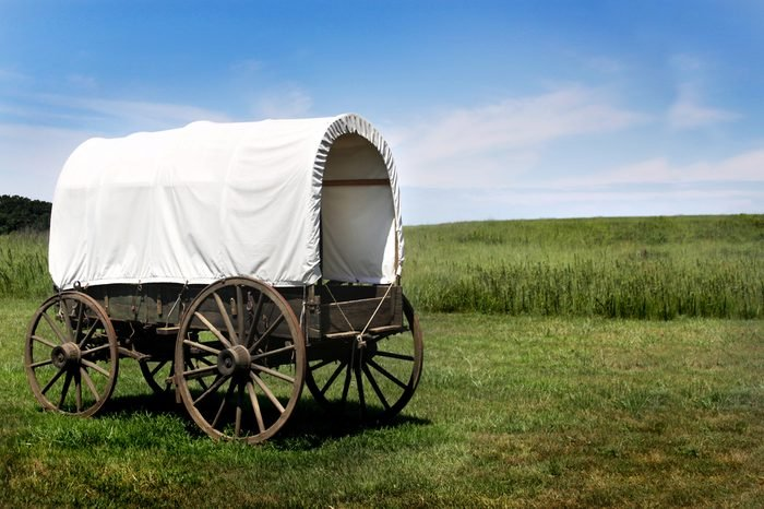 A pioneer covered wagon on the Prairie.