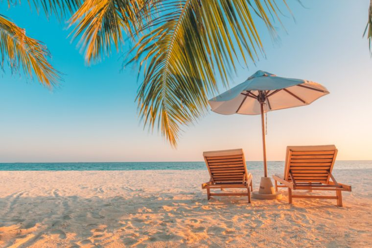 Tranquil beach scene. Exotic tropical beach landscape for background or wallpaper. Design of summer vacation holiday concept.