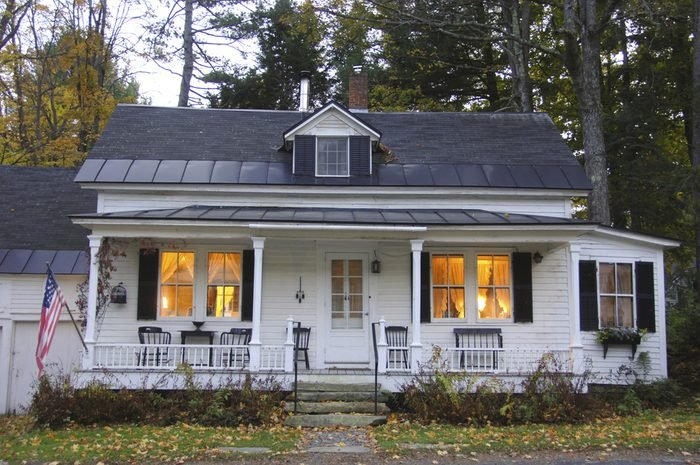 White clapboard house with a white picket fence