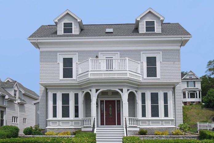 clapboard house with large porch