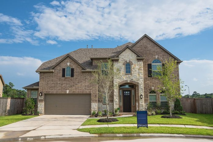 Brand new two story residential house in suburban American neighborhood at Humble, Texas, US. Newly constructed, freshly built modern home with landscaped yard.