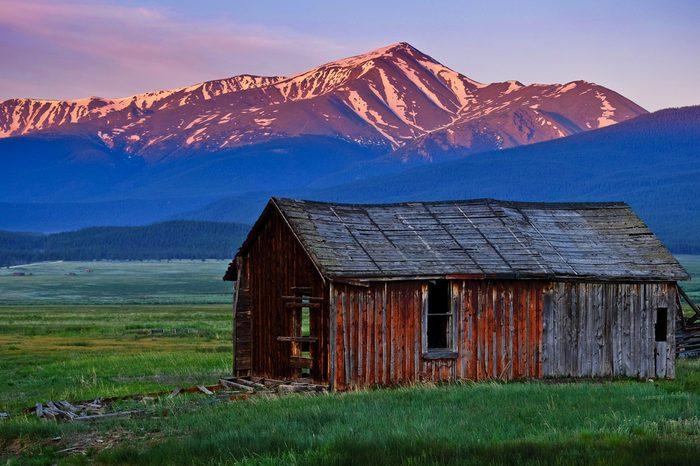 Sunrise Over Colorado's Tallest Peak and Old Barn.Mt Elbert, Colorado, USA.