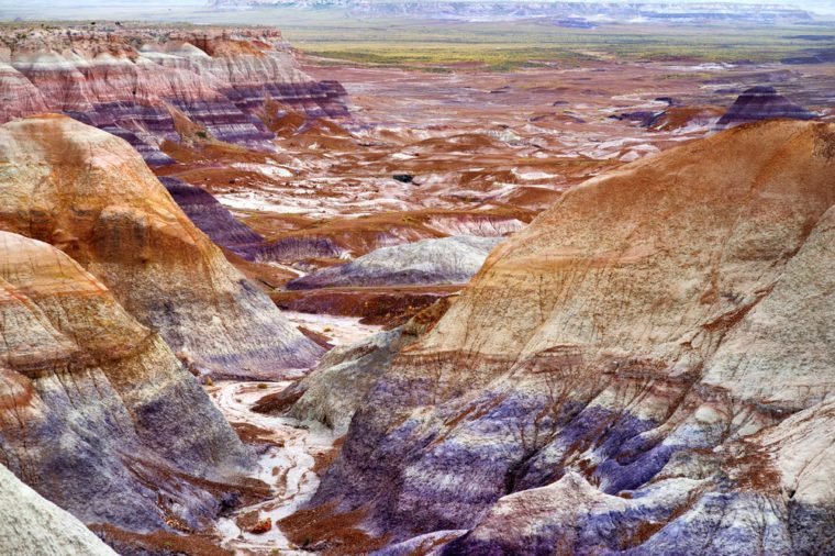 Striped purple sandstone formations of Blue Mesa badlands in Petrified Forest National Park, Arizona, USA