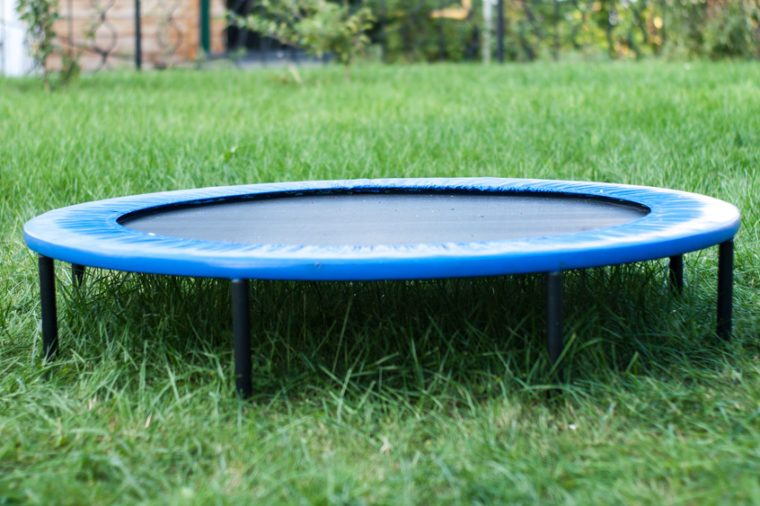 A Round Trampoline on the Back Yard Grass