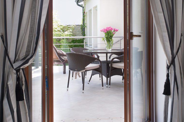 Close-up of open door to cozy terrace